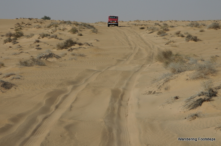 The narrow soft-sand track in Sharquiya Sands.