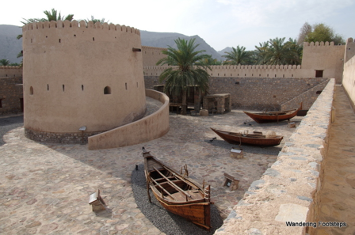 Inside Khasab Fort.  Wooden dhows from the region on display.