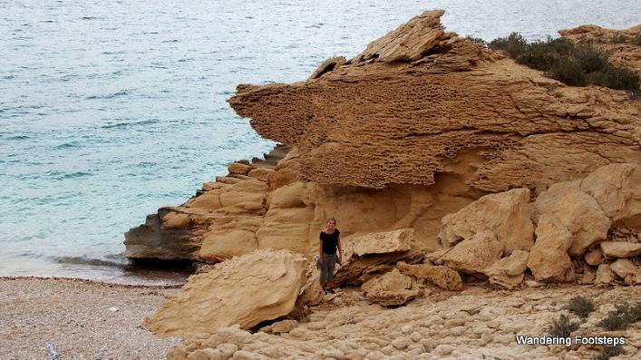Exploring a rocky beach along Oman's coast.
