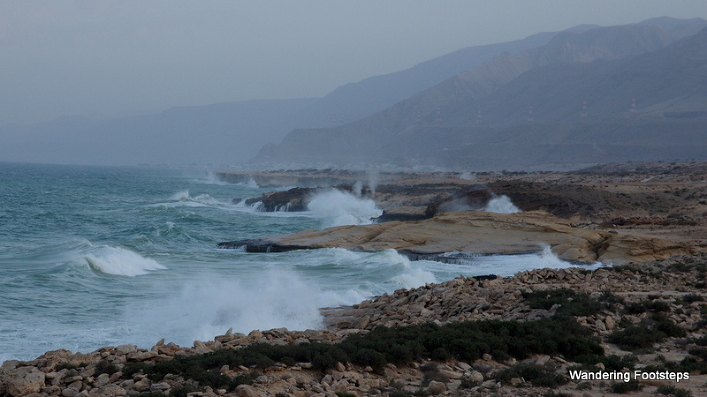 Waves crashing onto the rocky coast of windy Oman.