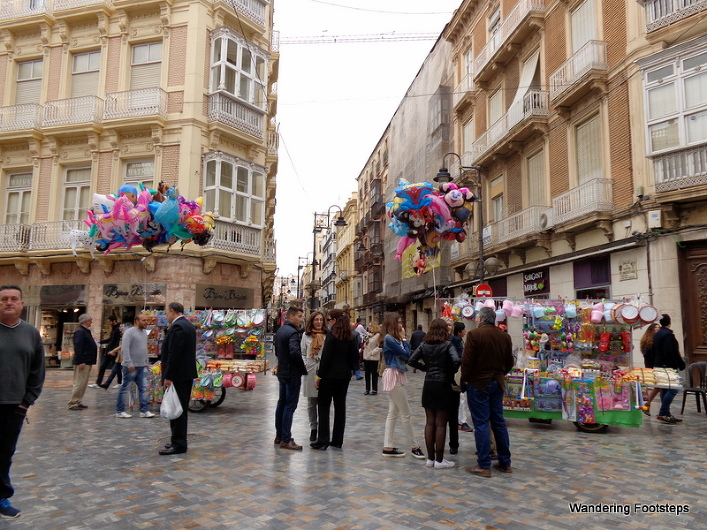 Balloons, carnival rides, and plastic toys for sale in the historical part of Cartagena.