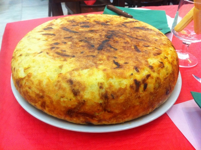 Spanish omelette, or tortilla.  I wish I had placed an object in this photo to show you exactly how large it is!