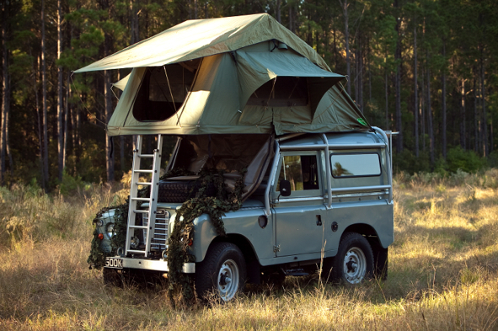 A Land Rover with a rooftop tent (what you see a lot of in Africa).