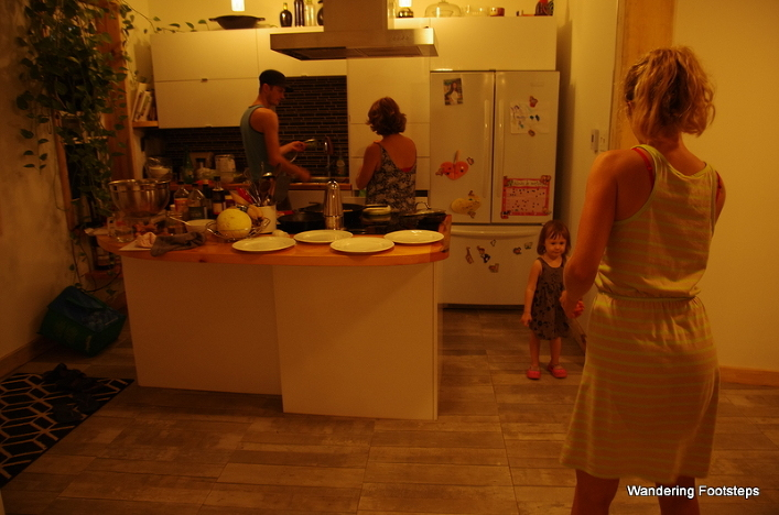 Nico and Jenn prepping us dinner while we play with Zoelle.