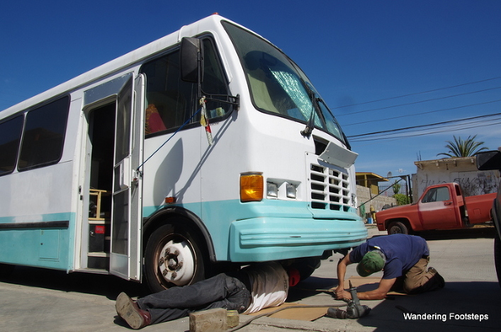The guys at the RV shop trying to help Bruno figure out this diesel leak.
