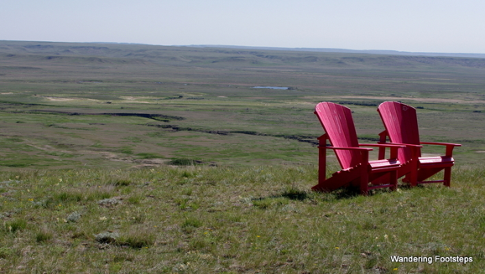 The vast, seemingly-featureless Grasslands National Park (and its red chairs - every Canadian National Park now has them!).
